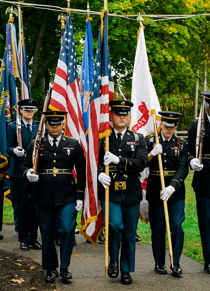 """Honor Guards present the colors during the ceremonies at """"The Wall That Heals"""" at Carter Park on Thursday morning. The wall, a 250-foot replica of the Vietnam Wall, is on display at Carter Park and ceremonies will be held daily through Saturday evening. SENTINEL & ENTERPRISE / Ashley Green"""