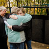"Kelly Dwyer embraces her mother, Margie Moore, in front of 'The Wall That Heals' while her aunt Dorie Cormier looks on at Carter Park on Thursday morning. Dwyer had just found her father, Alfred Dwyer's name on the wall. Dwyer was killed in Vietnam in 1968. ""The Wall That Heals"", a 250-foot replica of the Vietnam Wall, is on display at Carter Park and ceremonies will be held daily through Saturday evening. SENTINEL & ENTERPRISE / Ashley Green"