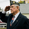 "US Navy veteran and candidate for State Representative Frank Ardinger salutes during the presentation of the colors during ceremonies at ""The Wall That Heals"" at Carter Park on Thursday morning. The wall, a 250-foot replica of the Vietnam Wall, is on display at Carter Park and ceremonies will be held daily through Saturday evening. SENTINEL & ENTERPRISE / Ashley Green"