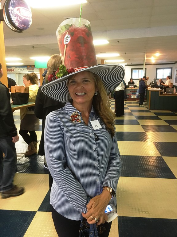 . Patti, from Clay, sports a raspberry mint julep hat during the Vernon Down\'s hat contest, hosted each year on Kentucky Derby day.