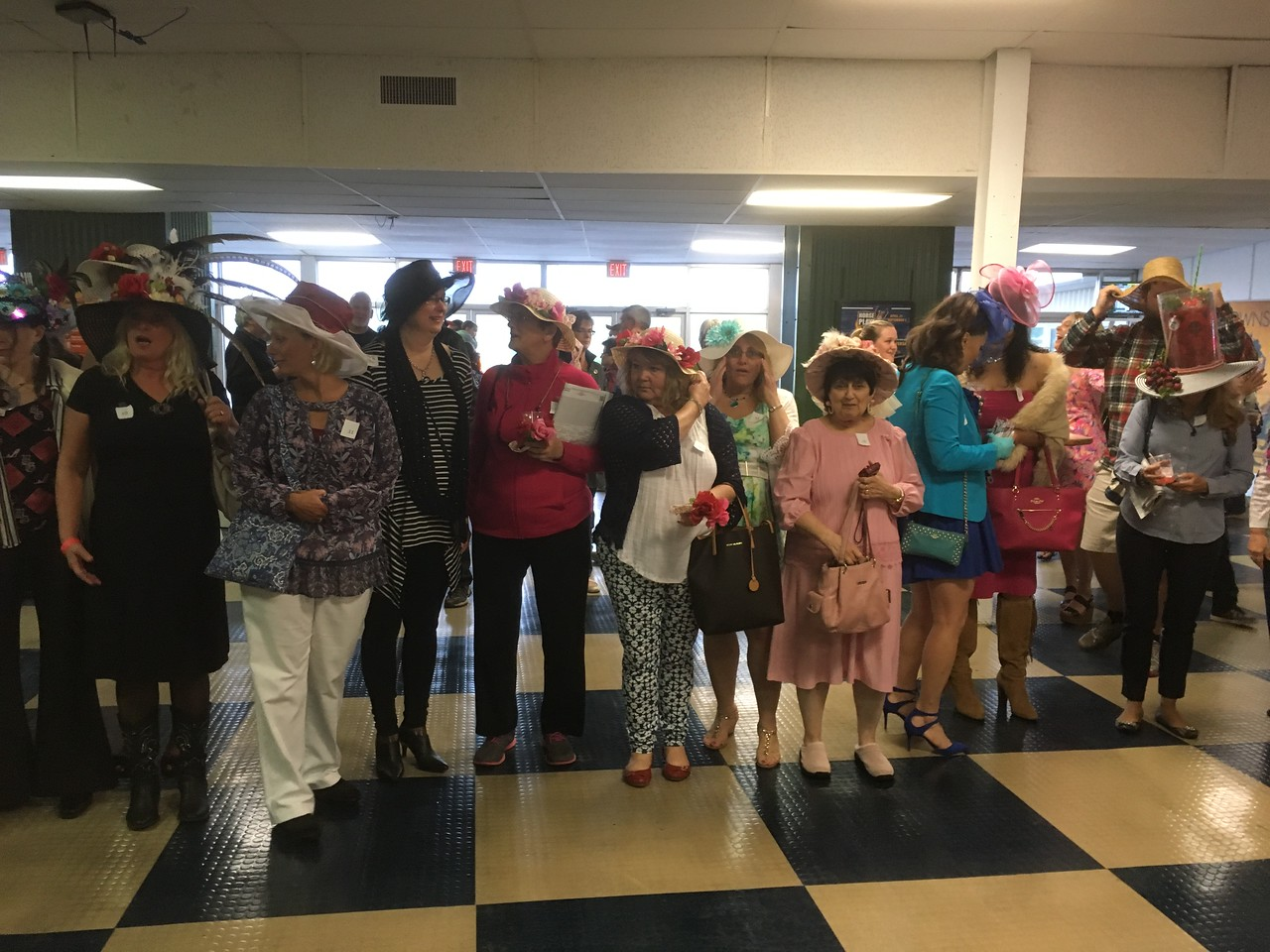 Contestants line up for the hat contest at Vernon Downs on Saturday, May 6.