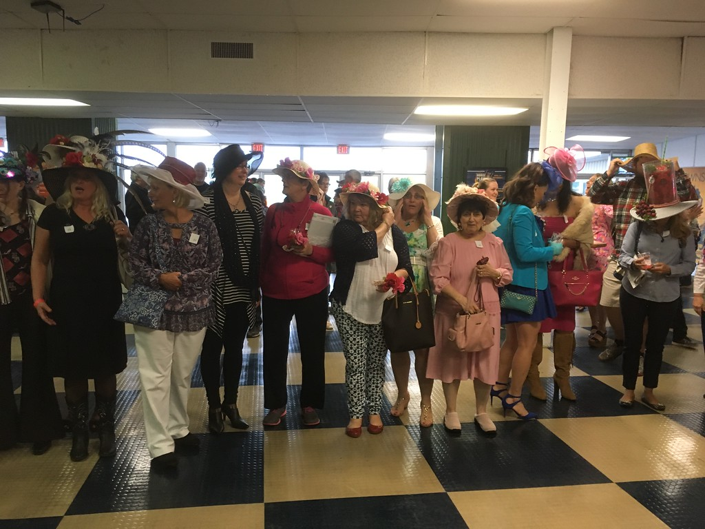 . Contestants line up for the hat contest at Vernon Downs on Saturday, May 6.