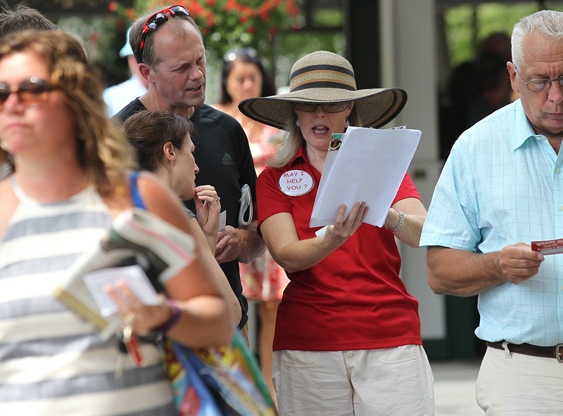 Spencer Tulis <br /> Mary Bulger of Nyack (in red, center) took her summer vacation this year to work in hospitality for the first time at Saratoga Race Course. She says she has been visiting the area and going to the track since she was a little girl. She has relatives that live in Troy.