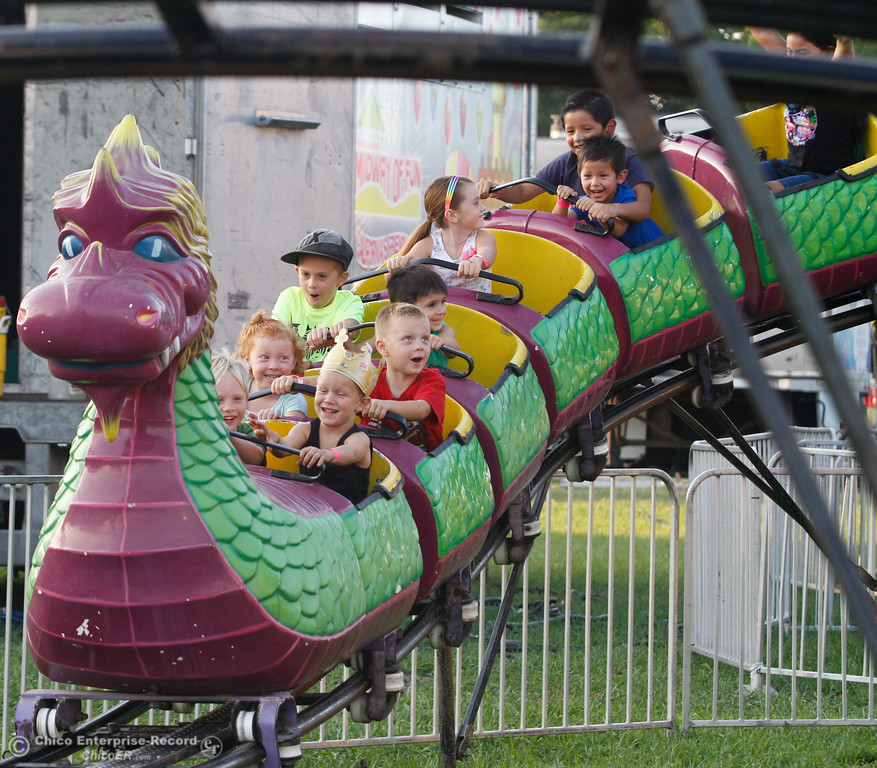. A group of kids ride the dragon roller coaster on the opening night of the 2017 Butte County Fair Thursday August 24, 2017 in Gridley, California. (Emily Bertolino -- Mercury-Register)