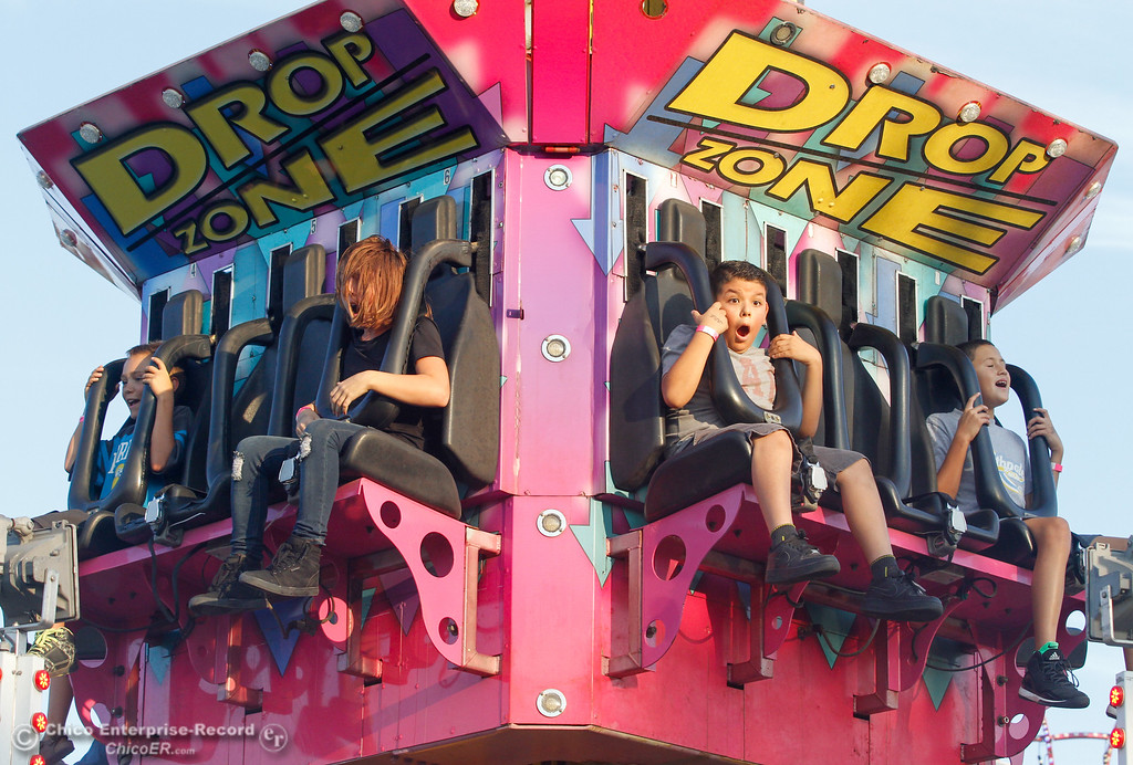 ". Jose Soto, 9, second from right, screams out as he rides the ""Drop Zone,\"" on the opening night of the 2017 Butte County Fair Thursday August 24, 2017 in Gridley, California. (Emily Bertolino -- Mercury-Register)"
