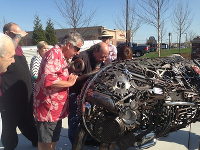 Pontiac welded-art sculptor Ron Finch unveiled his latest piece, Chris P. Bacon, a 7-foot hog, placed outside the newest Bad Brad's BBQ location, in Orion Township, on Friday, May 6, 2016. Photo by Nicole M. Robertson