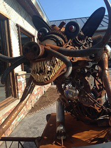 Pontiac welded-art sculptor Ron Finch assembles car and motorcycle parts along with tools and other metal objects. His artworks decorate the newest Bad Brad's BBQ, in Orion Township. The restaurant  had its soft open on Friday, May 6, 2016, followed by a grand opening on Sunday. Photo by Nicole M. Robertson