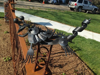 The fences in front of the newest Bad Brad's BBQ location, in Orion Township, are decorated with creatures made by Pontiac welded-art sculptor Ron Finch. The restaurant had is soft open on Friday, May 6, 2016, followed by a grand opening on Sunday. Photo by Nicole M. Robertson
