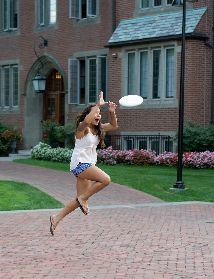September 8, 2015: Taft_Student fun. Emma Vermylen '17 catches a frisbee in front of the Macintosh House Dorm while hanging out with friends.  (Photo by Robert Falcetti/Taft)