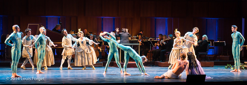 Members of the New York Baroque Dance Company and of the Seán Curran Company with bass François Lis and soprano Ingrid Perruche (foreground, facing dancers) in Opera Lafayette's production of Rameau's Les Fêtes de l'Hymen et de l'Amour ou Les Dieux d'Égypte