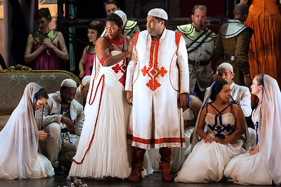 Michelle Johnson as Aida and Eric Owens as Amonasro with members of the ensemble in The Glimmerglass Festival production of Aida. Photo: Karli Cadel/The Glimmerglass Festival.