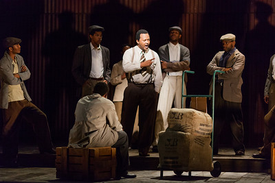 Amos Nomnabo as John Kumalo with members of the ensemble in The Glimmerglass Festival's production of Kurt Weill and Maxwell Anderson's Lost in the Stars. Photo: Karli Cadel/The Glimmerglass Festival.