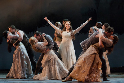 Andriana Chuchman as Guenevere (center) with members of the chorus in The Glimmerglass Festival's 2013 production of Camelot. Photo: Karli Cadel/The Glimmerglass Festival.