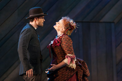 """Ryan McKinny as Billy Bigelow and Rebecca Finnegan as Mrs. Mullin in The Glimmerglass Festival's 2014 production of Rodgers and Hammerstein's """"Carousel."""" Photo: Karli Cadel/The Glimmerglass Festival."""