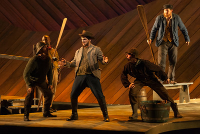 """Ben Edquist as Jigger Craigin (center) with members of the ensemble in The Glimmerglass Festival's 2014 production of Rodgers and Hammerstein's """"Carousel."""" Photo: Karli Cadel/The Glimmerglass Festival."""