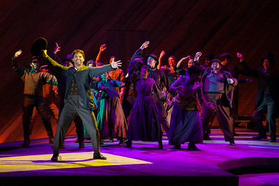 """Ryan McKinny as Billy Bigelow and the ensemble in The Glimmerglass Festival's 2014 production of Rodgers and Hammerstein's """"Carousel."""" Photo: Karli Cadel/The Glimmerglass Festival."""