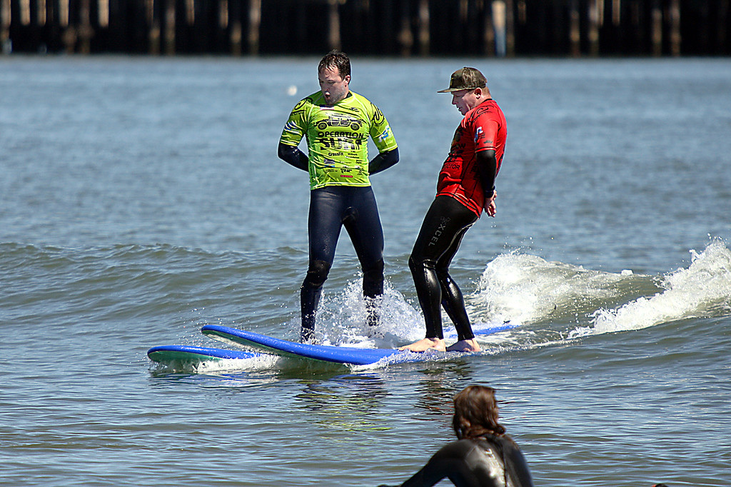 . Veteran James Jung learsn some style moves from Operation Surf Santa Cruz coach Joe Hutson on Monday afternoon. (Dan Coyro -- Santa Cruz Sentinel)