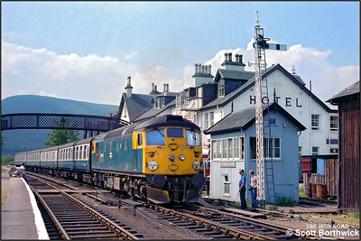 26035 working 2K08 1045 Inverness-Kyle of Lochalsh on 25/07/1983 had developed a hot axle box by the time it reached Achnasheen, where it was booked to cross 2N20 1110 Kyle of Lochalsh-Inverness hauled by 37025. 26035 was detached from its train and run into the adjacent platform allowing 37025 to be detached from 2N20 and run onto 2K08. 26035 then ran back onto 2N20 and hauled it into Achnasheen station. 37025 then set off back to Kyle of Lochalsh whilst 26035 was removed from its new train and dumped in a siding. Assistance for 2N20 arrived some two hours later in the form of 37183 from Inverness TMD. Here, 26035 is seen being detached from the Inverness bound service shortly after 37025 had departed to Kyle.