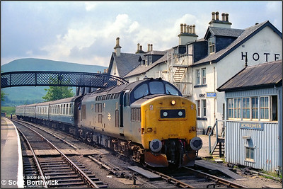 37183 is attached to 2N20 1110 Kyle of Lochalsh-Inverness at Achnasheen on 25/07/1983, after arriving from Inverness TMD. 26035 had earlier failed whilst working 2K08 1045 Inverness-Kyle of Lochalsh. 37025 was commandeered from 2N20 and worked 26035's train forward to Kyle of Lochalsh leaving 2N20 without a locomotive.