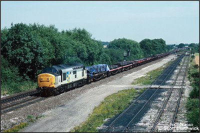 37203 passes Stenson Jnct whilst working 6V58 0915 MSX Scunthorpe BSC Entrance C-Cardiff Tidal TC on 25/07/1990.