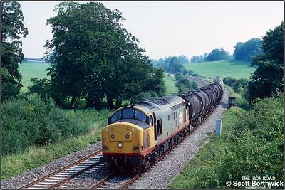 37371 passes Sherrington whilst working 6V62 1034 Fawley-Tavistock Jnct on 31/07/1992.