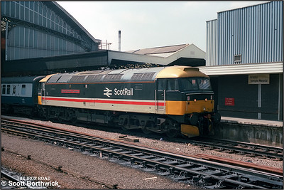 A long way from home, 47469 'Glasgow Chamber of Commerce' calls at Bristol Temple Meads whilst working 1E91 0933 Penzance-Newcastle on 09/08/1986.The loco had worked the train from Plymouth.