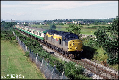 37156 'British Steel Hunterston' passes Muir of Ord golf course whilst working 2H84 1510 Kyle of Lochalsh-Inverness on 13/07/1993.