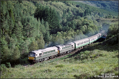 Working hard upgrade through Achnashellach Forest, 26001+26007 head back to Inverness with 2H86 1705 Kyle of Lochalsh-Inverness on 25/08/1993.