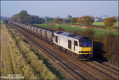 60084 traverses the Stenson Jnct-Sheet Stores Jnct freight only line on 19/11/2001 with a train of empty HAAs for Toton Yard.
