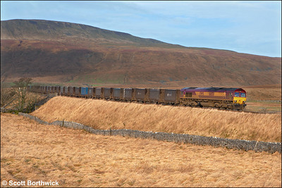 66150 has 39 PFA's in tow whilst working 6E49 0855 Newbiggin-Milford Sdgs gypsum etys at Ribblehead on 21/06/2006.