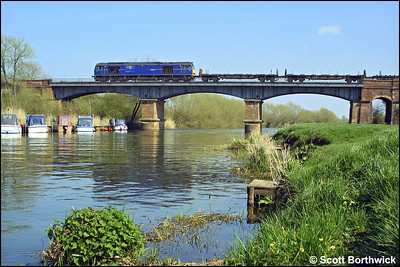 60044 is pictured crossing the River Avon at Eckington Bridge with 6E09 0939 Margam-Lackenby on Good Friday, 09/04/2004.