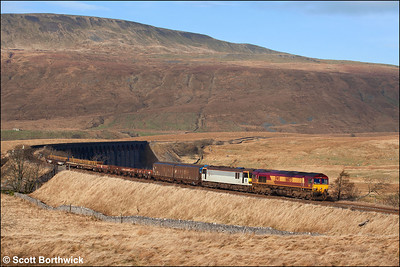 66073 drags 92029 and 6M76 Carlisle Yard-Warrington Arpley at Ribblehead on 21/01/2006. It is possible that this was the first Class 92 to traverse the S&C.