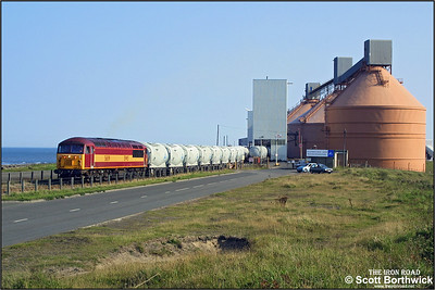 The following seven photographs show 56119 working one of the shortest (distance wise) traffic flows in the UK. Every weekday afternoon a locomotive would arrive at North Blyth from Tyne Yard. After collecting a rake of loaded hoppers, the train would run to Lynemouth Aluminium smelter with its load of alumina. At Lynemouth the loaded wagons would be exchanged for an empty set, which were then returned to North Blyth for loading. The locomotive would then return light back to Tyne Yard. Here 56119 is pictured at the North Blyth terminal shunting the wagons that will form 6N69 1524 North Blyth-Lynemouth on 11/09/2002.
