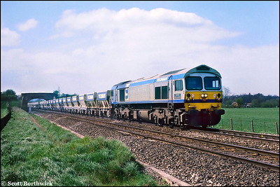 59003 approaches Westbury at Fairwood with a Saturday trip working of Mendip aggregate from Merehead Quarry to Westbury Yards on 23/04/1988.