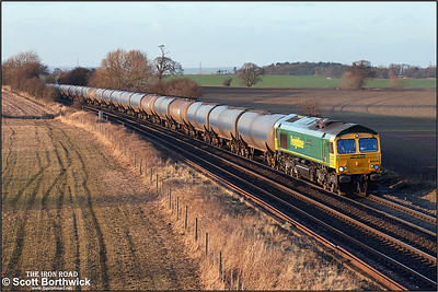 66618 catches some golden winter sunshine at Portway on 18/02/2005 whilst in charge of 6M00 1123 Humber Oil Refinery-Kingsbury Oil Sdgs.