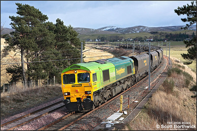 66522 catches a patch of sunshine as it heads north between Crawford & Abington in the Scottish Borders with 4Z41 0630 Ferrybridge Power Station-Hunterston coal empties on 04/03/2005.