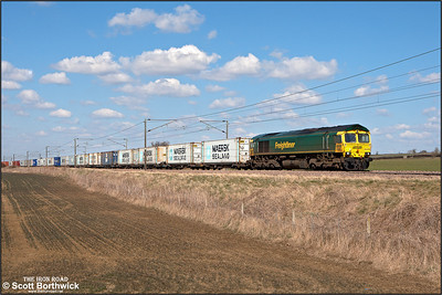 66590 has a well loaded 4L85 1228 Doncaster PF-Felixstowe North FLT in tow as it passes Frinkley Lane, Marston on 03/04/2013.
