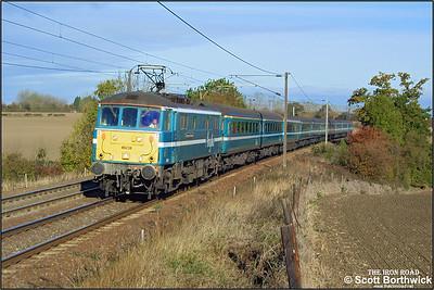 86238 'European Community' passes Dagworth whilst working 1P25 0940 Norwich-London Liverpool Street on 25/10/2003.