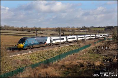 390131 passes Barby Nortoft whilst forming 9S80 1431 London Euston-Edinburgh Waverley on 17/03/2021.