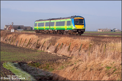 170511 is pictured approaching March at Middle Drove LC on 22/01/2005 whilst working 1L06 0831 Nottingham-Norwich.