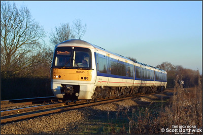 168003 begins the ascent of Hatton bank on 31/12/2001 with a Warwick Parkway-Hatton ECS working.