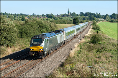 68010 powers past Kings Sutton whilst working 1K45 1615 London Marylebone-Kidderminster on 12/08/2016.
