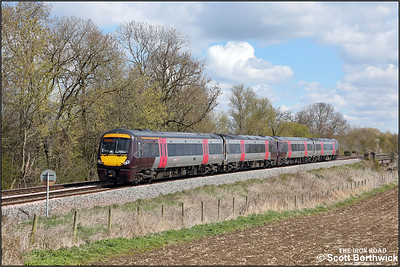 170115+170114 form 1N51 1100 Cambridge-Birmingham New Street approaching Rotherby on 12/04/2021. (A lineside solar panel has been digitally removed).