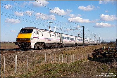 91115 'Blaydon Races' passes Broad Fen Lane, Claypole whilst working 1S23 1530 London King's Cross-Glasgow Central on 03/04/2013.