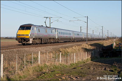 91127 passes Broad Fen Lane, Claypole whilst propelling 11A43 1715 Leeds-London King's Cross on 03/04/2013.