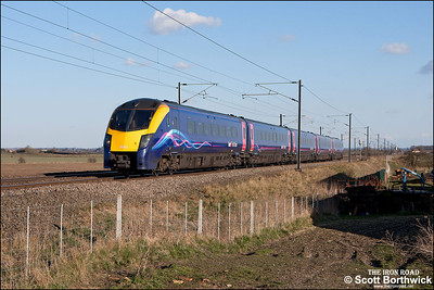 180113 passes Broad Fen Lane, Claypole whilst forming 1H05 1548 London King's Cross-Hull on 03/04/2013.
