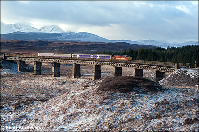 The sun breaks through to illuminate 37406 crossing Rannoch Viaduct on a cold and frosty 04/03/2005 whilst working 1Y11 0450 Edinburgh-Fort William. The sleeping cars had originated from London Euston.