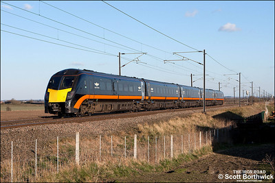 180101 passes Broad Fen Lane, Claypole whilst forming 1A67 1537 Bradford Interchange-London King's Cross on 03/04/2013.