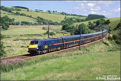 Running around 40 minutes late, 91121 'Archbishop Thomas Cranmer' heads 1S18 1000 London Kings Cross-Edinburgh Waverley at Houndwood on 11/07/2003.
