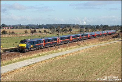 A GNER 225 set with 82204 being propelled by 91109 speeds past Colton Jnct on 09/10/2004 with 1E04 0859 Newcastle-London Kings Cross. A special timetable was in operation due to the ECML being blocked by engineering work between Newcastle & Edinburgh.